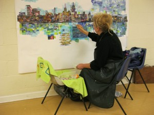art classes, beginners, merseyside. artist at work on large art piece, liverpool waterfront